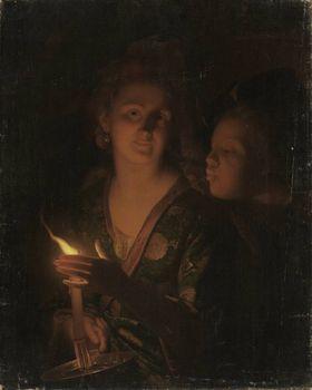 Ein Junge versucht einem Mädchen die Kerze auszublasen