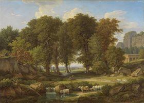 Baumgruppe mit Kühen an der Tränke
