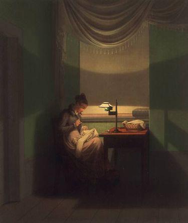 Junge Frau, beim Schein einer Lampe nähend